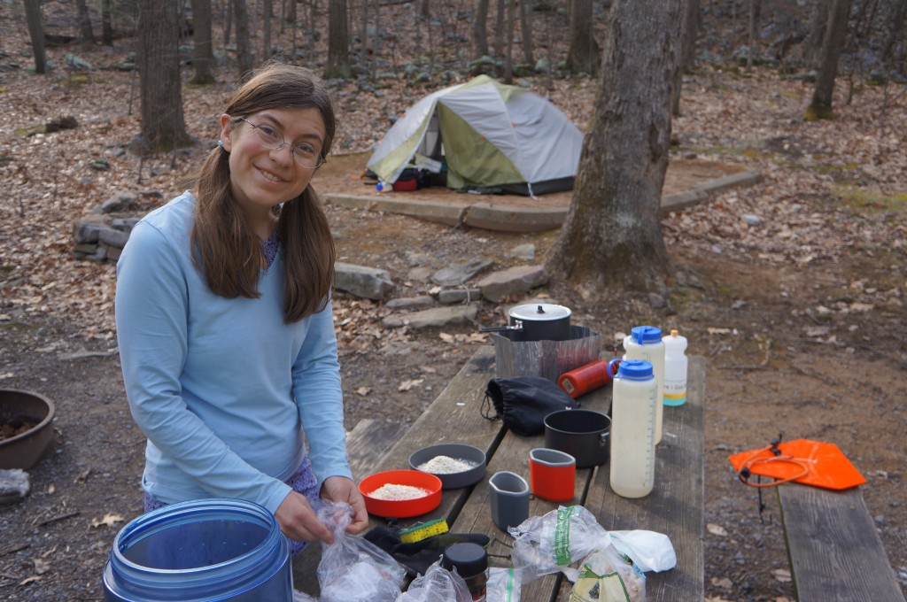 Daisy cooking dinner at our campsite in TCSP.