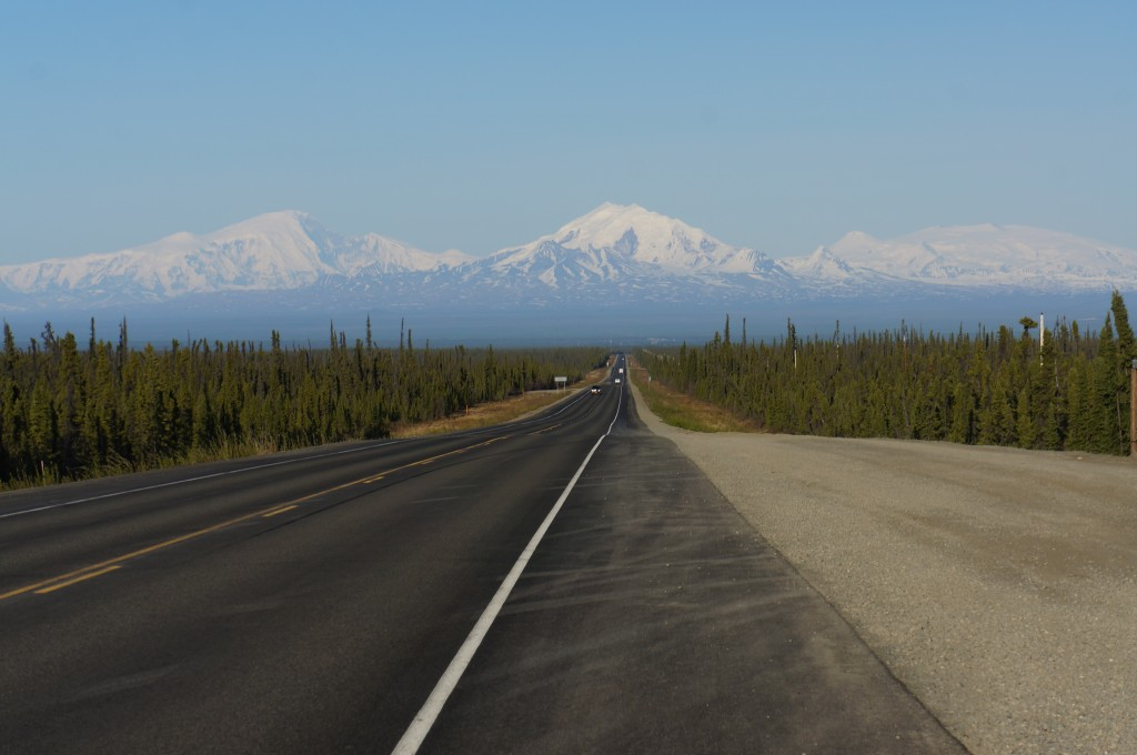 The road leads straight towards the Wrangell Mountains