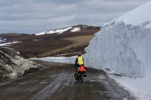 Recently opened road next to big snow wall.
