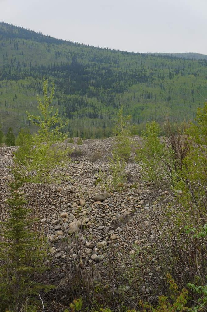 Tailings cover the entire valley.