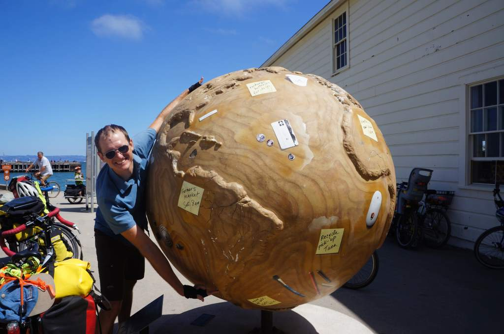 We found a big globe, and Jason had long enough arms to span our entire trip!