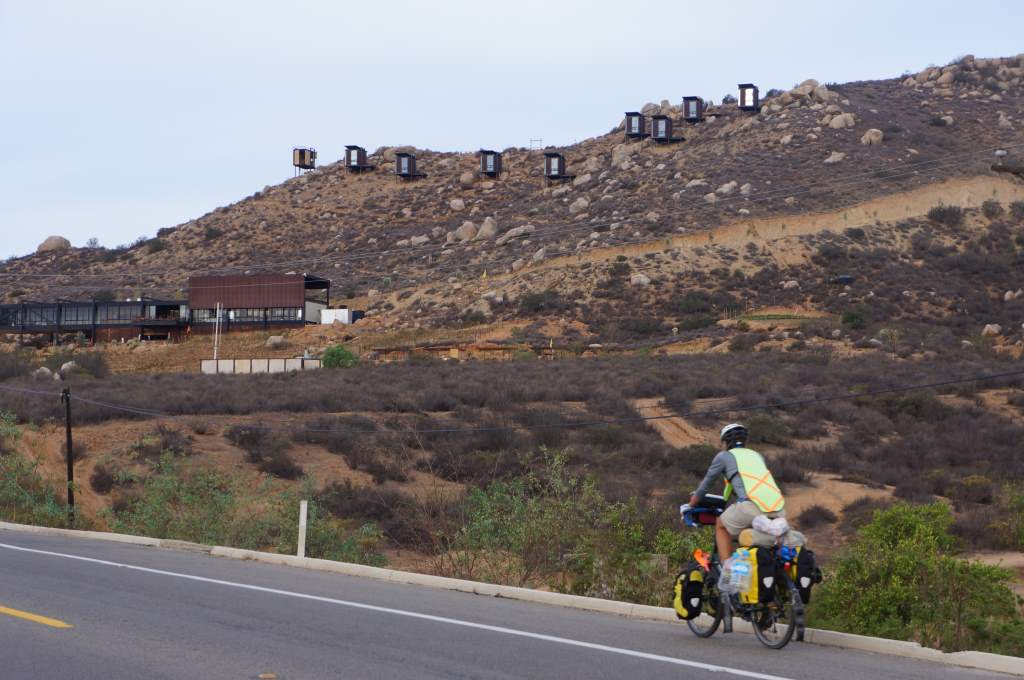 Back on the road in the morning.  In the background: bizarre hotel rooms on the hill.