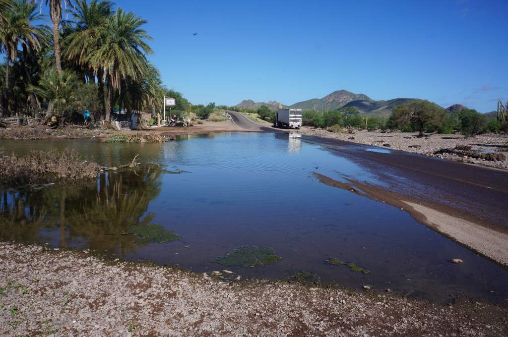In some places the road is still flooded from the hurricane.