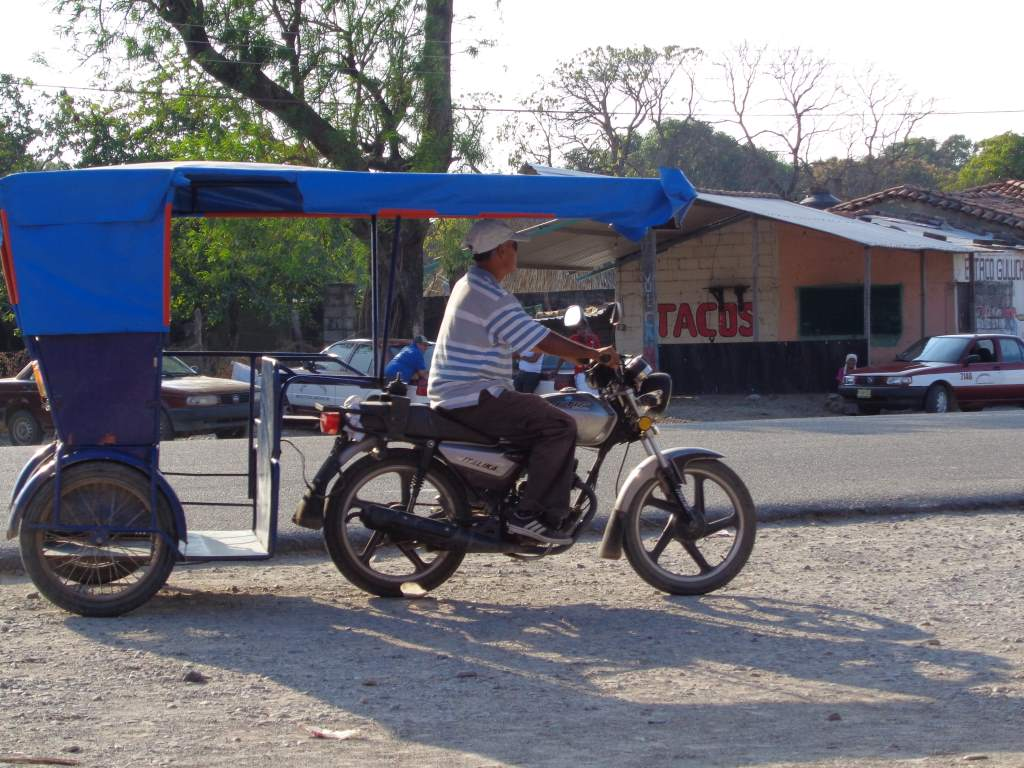 These motorcycle-taxis are everywhere here with many modifications.