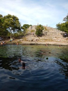 The ruins even had a cenote that we could swim in!  The heads in the foreground are ours...