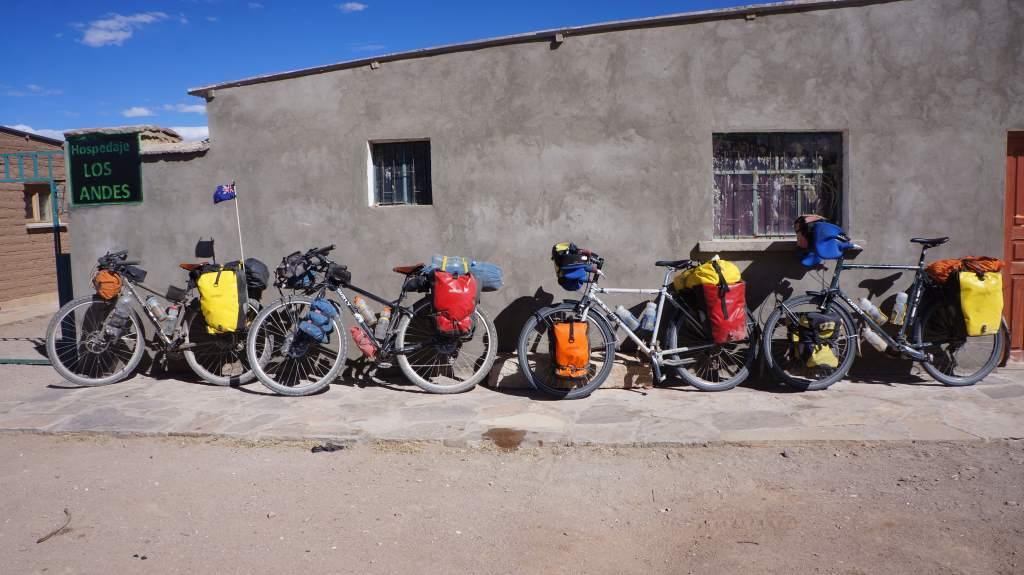 Four bikes at a hostel.