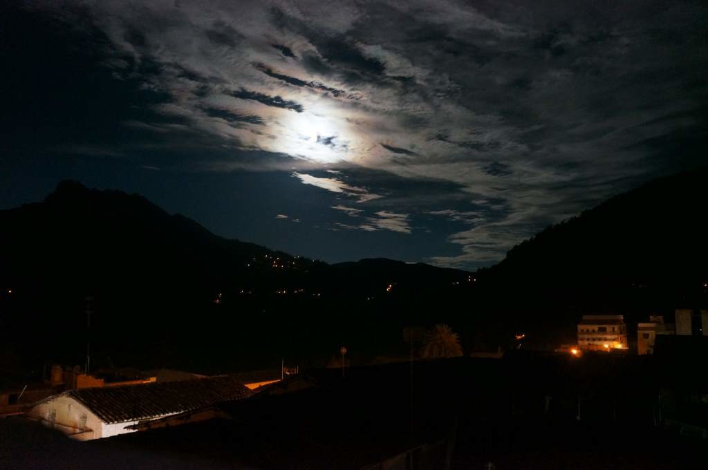 A full moon over a Peruvian village.