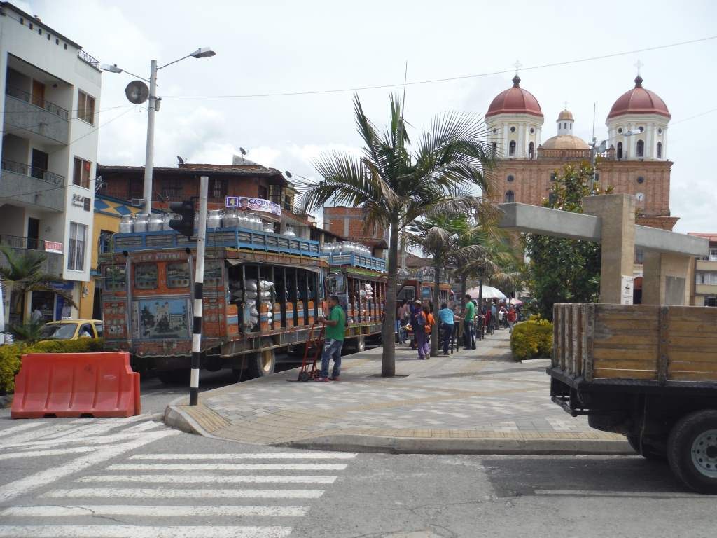 Local buses line up in a hill town