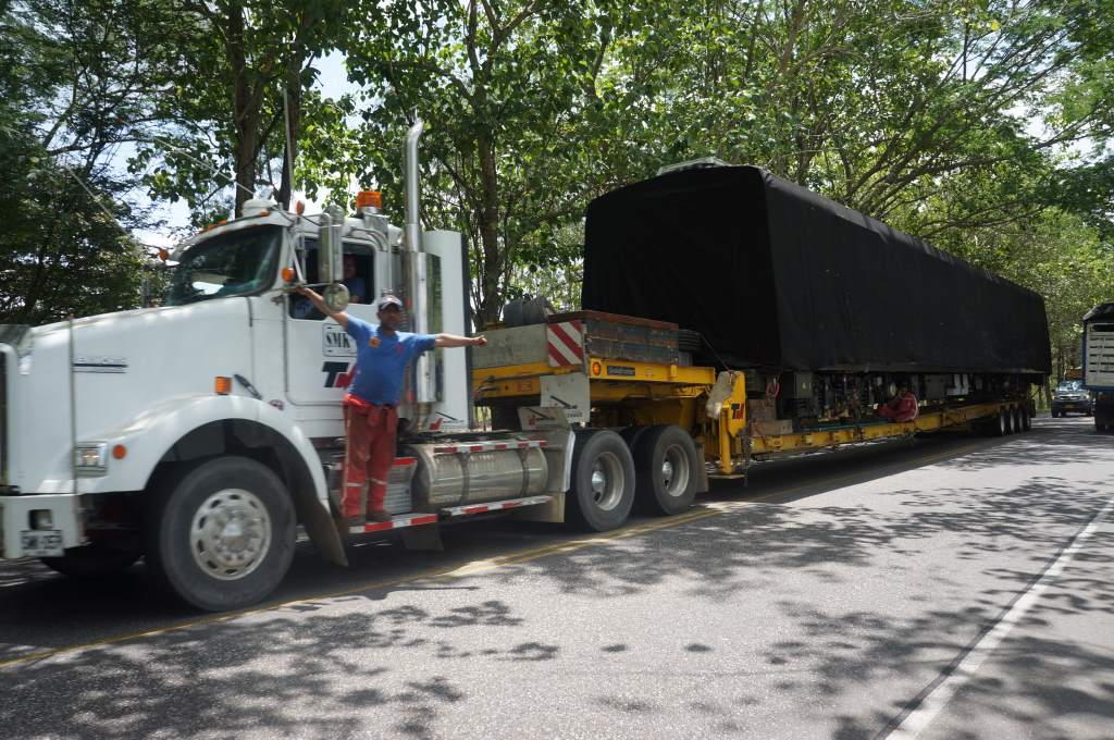 The cargo is a new metro car for Medellin. There were at least 3 guys not in the cab as the truck was moving.