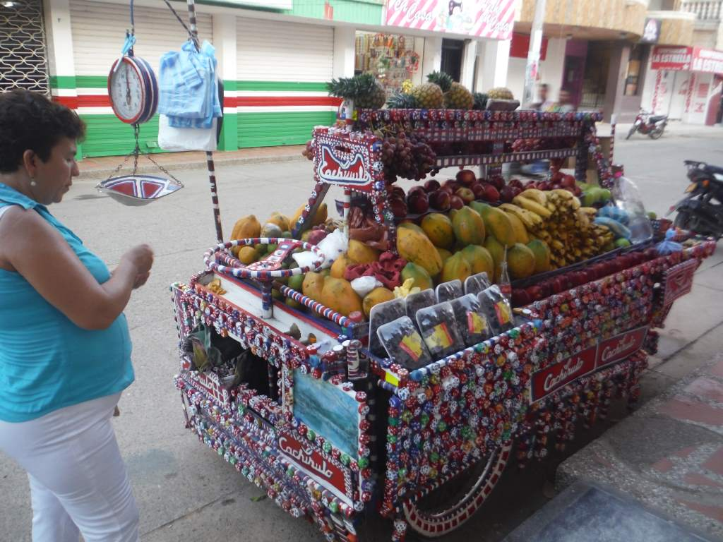 This lady made her own fruit cart. It took her 2 months to decorate it with bottle caps.